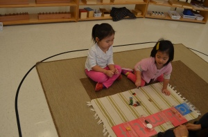Toddlers matching objects with sound cards