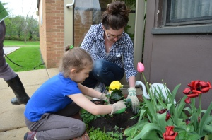 Children plant flowers.
