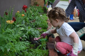 Even the youngest join in on the gardening.