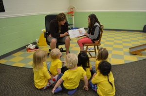 An alumni comes to read special books to children.