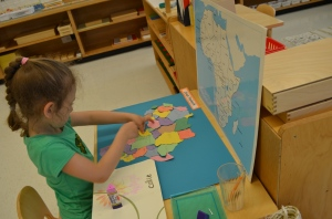 An older student finishes up her Africa map.