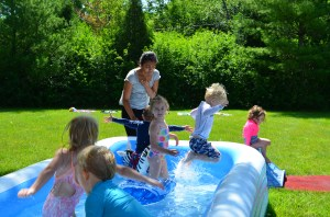 Children love to go swimming, especially on a hot day like this!